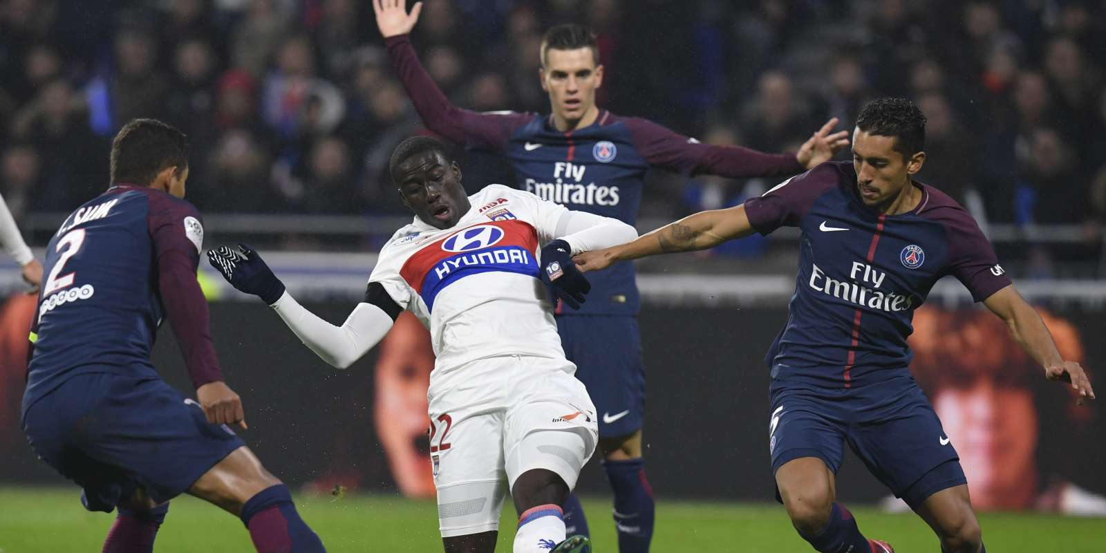 Lyon's French defender Ferland Mendy (C) vies with Paris Saint-Germain's Brazilian defender Thiago Silva (L), Paris Saint-Germain's Brazilian defender Marquinhos (R) and Paris Saint-Germain's Argentinian midfielder Giovanni Lo Celso during the French L1 football match between Olympique Lyonnais and Paris-Saint Germain (PSG) at Groupama stadium in Decines-Charpieu on January 21, 2018. / AFP / PHILIPPE DESMAZES
