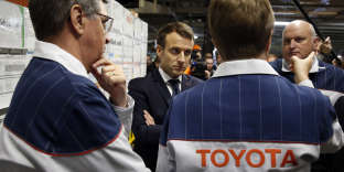 French President Emmanuel Macron visits Toyota's automobile manufacturing plant with Director Luciano Biondo, right, in Onnaing, northern France, Monday, Jan. 22, 2018. (Pascal Rossignol/Pool Photo via AP)