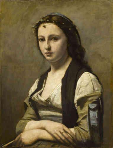 « Dans cette peinture, la pose est inspirée par « La Joconde ». Il n'y a pas de perle mais une couronne de lierre : le titre (« La Femme à la perle»), erroné car donné plus tard, repose sur une mauvaise interprétation inconographique. »