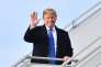 """EDITORS NOTE: Graphic content / US President Donald Trump waves as he arrives on January 25, 2018 in Zurich en route to the World Economic Forum in Davos. Trump was transferring to a helicopter to complete the journey to the Alpine village, where the world's political and business elite are anxious to hear what the president intends to say about his """"America First"""" agenda. / AFP / Nicholas Kamm"""