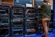 A man works next to servers specialised in cyber security during the 10th International Cybersecurity Forum in Lille on January 23, 2018. / AFP PHOTO / PHILIPPE HUGUEN