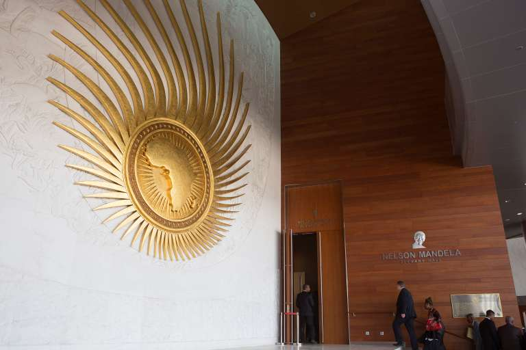 Delegates attending the 28th African Union (AU) Heads of State Summit walk into the main plenary hall at the AU hearquarters prior to the opening ceremony on January 30, 2017 in Addis Ababa. African Union leaders meet for a summit that has exposed regional divisions as they mull whether to allow Morocco to rejoin the bloc, and vote for a new chairperson. The two-day summit in Ethiopia comes after several shake-ups on the international stage: the election of US President Donald Trump and a new head of the UN, Antonio Guterres, who will address the opening of the assembly. / AFP PHOTO / Zacharias ABUBEKER