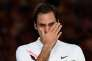 Switzerland's Roger Federer cries as he holds the winner's trophy after beating Croatia's Marin Cilic in their men's singles final match on day 14 of the Australian Open tennis tournament in Melbourne on January 28, 2018. -- IMAGE RESTRICTED TO EDITORIAL USE - STRICTLY NO COMMERCIAL USE --  / AFP / SAEED KHAN / -- IMAGE RESTRICTED TO EDITORIAL USE - STRICTLY NO COMMERCIAL USE --