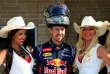 Le pilote Sebastian Vettel entouré de « grid girls» lors du Grand Prix des Etats-Unis, en 2014.