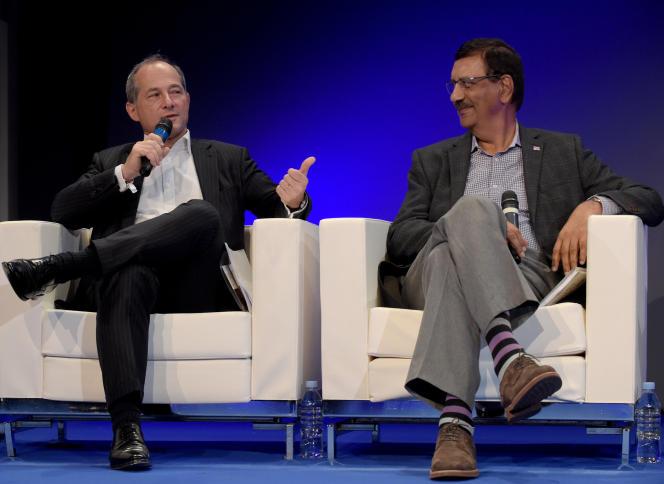 Le directeur général de la Société générale, Frédéric Oudéa, et le patron deBankMobile, Jay Sidhu, lors du Paris Fintech Forum, à Paris, le 30 janvier.