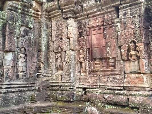 Des dizaines d'apsaras, danseuses célestes toutes différentes, animent les parois de grès du temple de Banteay Kdei, un des joyaux du site d'Angkor, pourtant ignoré des visiteurs.