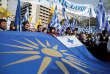 """REFILE - CORRECTING THE NAME OF THE FLAG People hold a flag depicting the Vergina Sun during a rally against the use of the term """"Macedonia"""" in any settlement to a dispute between Athens and Skopje over the former Yugoslav republic's name, in Athens, Greece, February 4, 2018. REUTERS/Costas Baltas"""