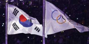 Pyeongchang 2018 Winter Olympics ? Opening ceremony ? Pyeongchang Olympic Stadium - Pyeongchang, South Korea ? February 9, 2018 - South Korea's and Olympic flags flutter during the opening ceremony. REUTERS/Kim Kyung-Hoon
