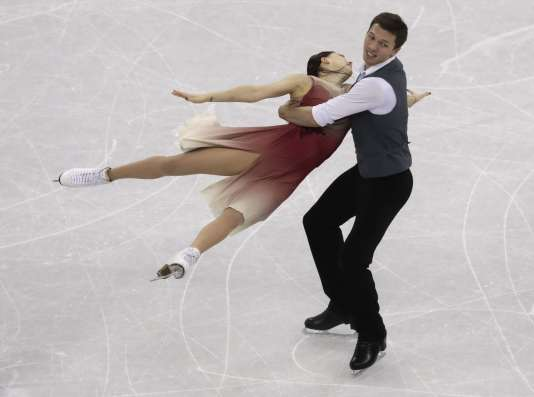 Dmitri Soloviev and Ekaterina Bobrova of the Olympic Athletes of Russia perform in the ice dance free dance figure skating team event in the Gangneung Ice Arena at the 2018 Winter Olympics in Gangneung, South Korea, Monday, Feb. 12, 2018. (AP Photo/Morry Gash)