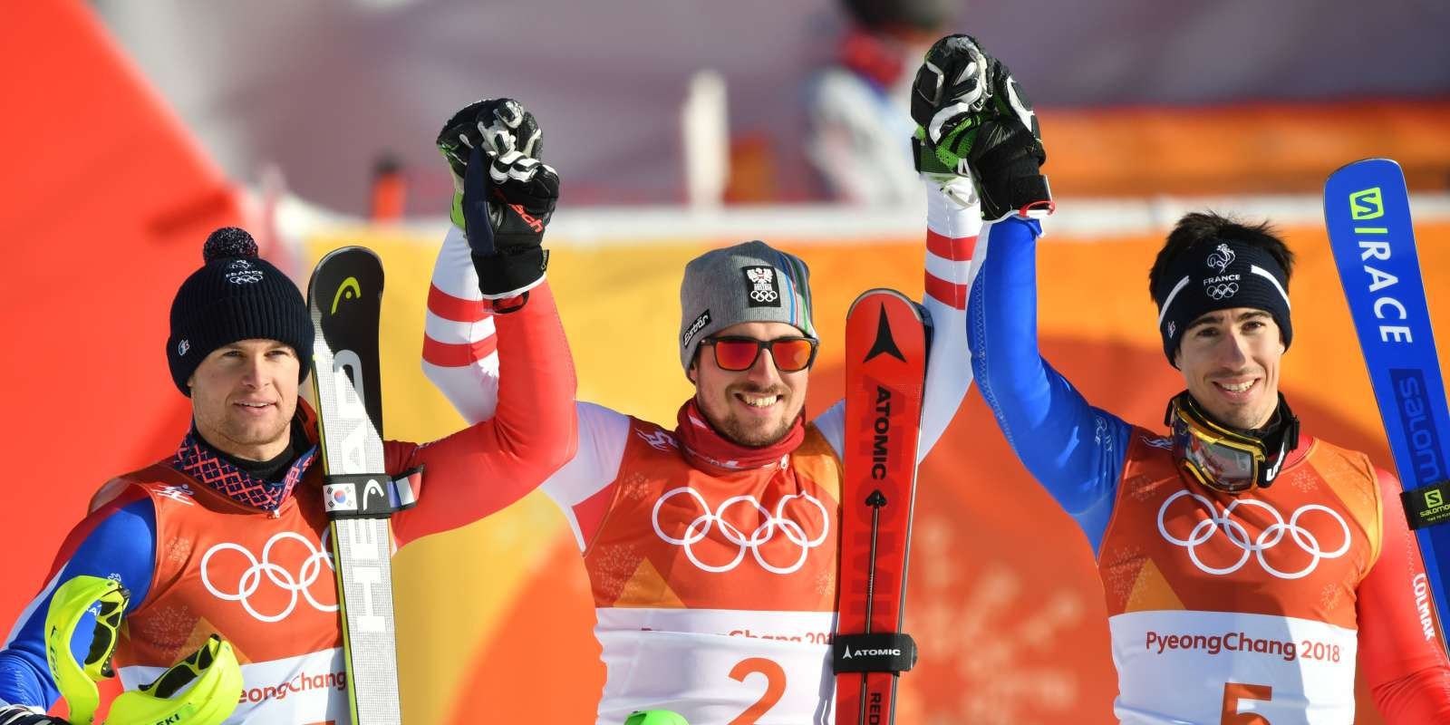 France's Alexis Pinturault (L), silver medal, Austria's Marcel Hirscher (C), gold, and France's Victor Muffat-Jeandet, bronze, celebrate in the finish area after competing in the Men's Alpine Combined Slalom at the Jeongseon Alpine Center during the Pyeongchang 2018 Winter Olympic Games in Pyeongchang on February 13, 2018. / AFP / Fabrice COFFRINI
