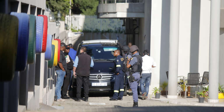 South African policemen outside the home of the Gupta family in Johannesburg on 14 February.