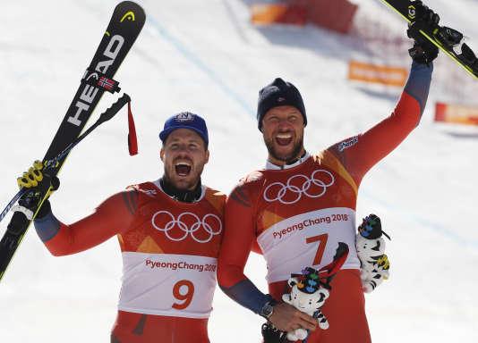 Les deux norvégiens KjetilJansrud (médaille d'argent) et Aksel LundSvindal (or) ont pris les deux premières places de la descente, jeudi 15 février à Pyeongchang. (AP Photo/Christophe Ena)