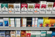 FILE - This Monday, Aug. 28, 2017 file photo shows cigarettes displayed on a store shelf in New York. On Friday, Feb. 16, 2018, The Associated Press has found that stories circulating on the internet that Philip Morris Marlboro 'M' brand marijuana brand cigarettes are now for sale in four U.S. states are untrue. (AP Photo/Mark Lennihan)