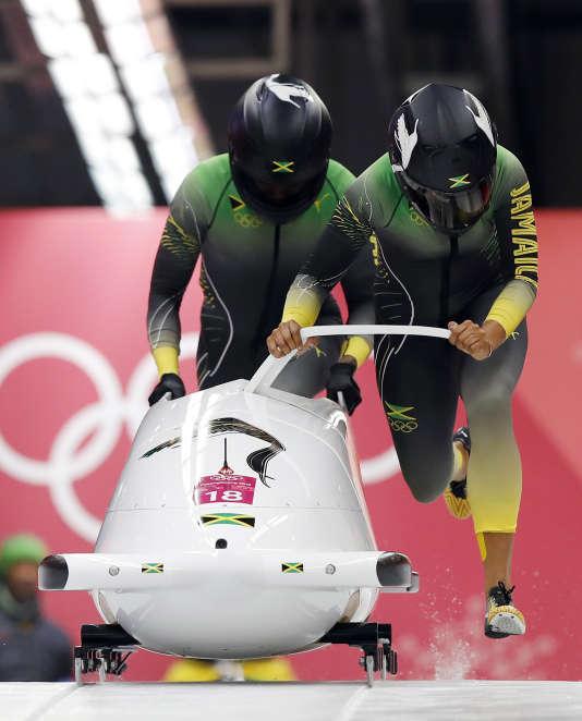 Deux bobeuses jamaïcaines et Usain Bolt.