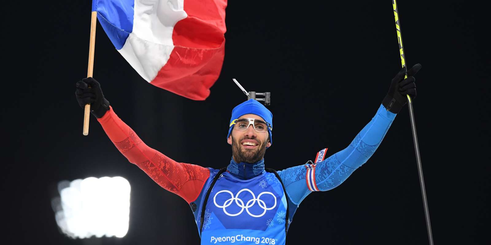 France's Martin Fourcade cross the finish line to win team gold in the mixed relay biathlon event during the Pyeongchang 2018 Winter Olympic Games on February 20, 2018, in Pyeongchang. / AFP / FRANCK FIFE