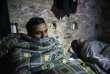 Un migrant pakistanais a trouvé refuge dans un bâtiment abandonné de la ville grecque de Thessalonique, le 14 janvier 2018.