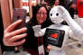 A visitor takes a selfie with the Robot Assistant Pepper, from SoftBank Robotics, during the Mobile World Congress in Barcelona, Spain February 28, 2017. REUTERS/Yves Herman