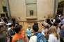 Le public autour de «La Joconde», au Louvre, à Paris, en 2009.