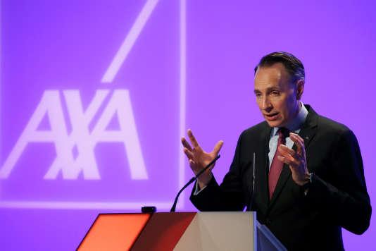 Thomas Buberl, directeur général d'Axa, présente les résultats de l'assureur français, à Paris, le 22 février.