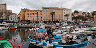 FILE PHOTO: A man stands on his fishing boat in the harbour of Ajaccio on the French Mediterranean island of Corsica January 30, 2018.  REUTERS/Jean-Paul Pelissier/File Photo