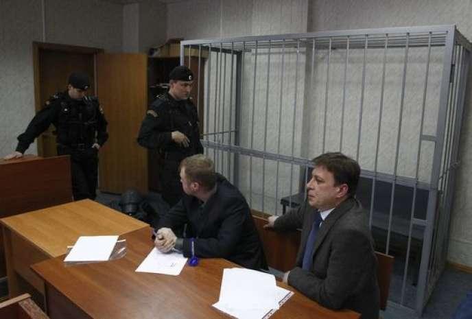 Les avocats de Sergueï Magnitski lors de son procès posthume, à Moscou, le 22 mars 2013. M. Magnitski est mort en détention le 16 novembre 2009.