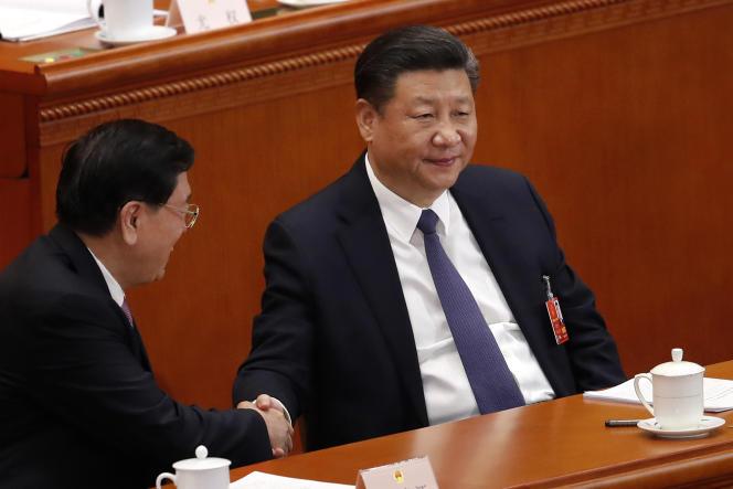 Le président Xi Jinping, lors de la session plénière de l'Assemblée nationale populaire, au palais du peuple de Pékin,le 11 mars.