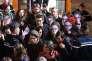Des prévenusentourés de leurs amis, certains portant un masque à l'effigie du procureur, au palais de justice de Paris, le 13 mars.