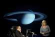 (FILES) In this file photo taken on April 21, 2008, British physicist Stephen Hawking (L) and his daughter Lucy Hawking give a lecture entitled 'Why We Should Go Into Space' during the 50 Years of NASA lecture series at George Washington University in Washington, DC. Renowned British physicist Stephen Hawking, whose mental genius and physical disability made him a household name and inspiration across the globe, has died at age 76, a family spokesman said on March 14, 2018. / AFP / Jim WATSON