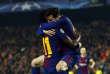 Lionel Messi et Ousmane Dembélé après le deuxième but du FC Barcelone face à Chelsea, en 8es de finale retour de la Ligue des Champions, au Camp Nou, le 14 mars.