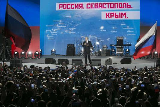 Vladimir Poutine en meeting en Crimée le 14 mars célébrantles quatre ans du référendum qui a suivi la prise de contrôle du territoire par les forces spéciales russes.