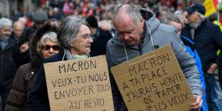"""Pensioners demonstrate along with striking EHPAD (Establishment for the Housing of Elderly Dependant People) employees, on March 15, 2018 in Rennes, as part of a nation-wide movement of retired workers to protest against a new hike in a tax taken from their pensions, while EHPAD workers call for more resources. The placards mean: """"Macron, do you want to make us all go to the Restos du Coeur (a Charity founded by the late Coluche)?"""", """"Macron, if I were you, I would be ashamed of taking money from the elderly"""" / AFP / Damien MEYER"""