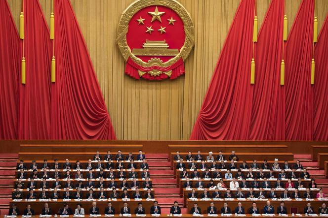 Lors de la quatrième session plénière du Congrès national du peuple, le 13 mars, au grand palais du peuple, à Pékin.