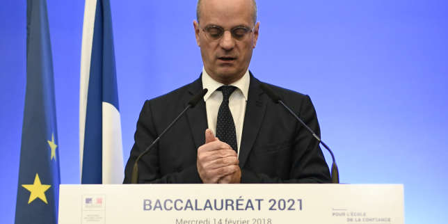 French Education Minister Jean-Michel Blanquer looks briefly down as he addresses a press conference on the reform of the Baccalaureat (France's high school diploma) at the Ministry of National Education in Paris on February 14, 2018. / AFP PHOTO / STEPHANE DE SAKUTIN