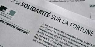 This picture taken on October 15, 2016 shows a solidarity tax on wealth form (Impot de Solidarite sur la Fortune or ISF in French) in Rennes, western France. / AFP PHOTO / DAMIEN MEYER