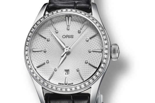 Date Diamonds, Oris Artelier, avec mouvement automatique et une lunette sertie de diamants, 3 000 €.