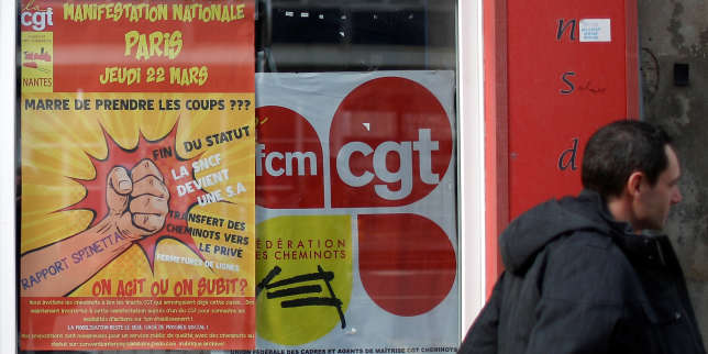 A man passes the premises of the union of the CGT railworkers (Cheminots), near a rail station in Nantes, France March 20, 2018. REUTERS/Stephane Mahe