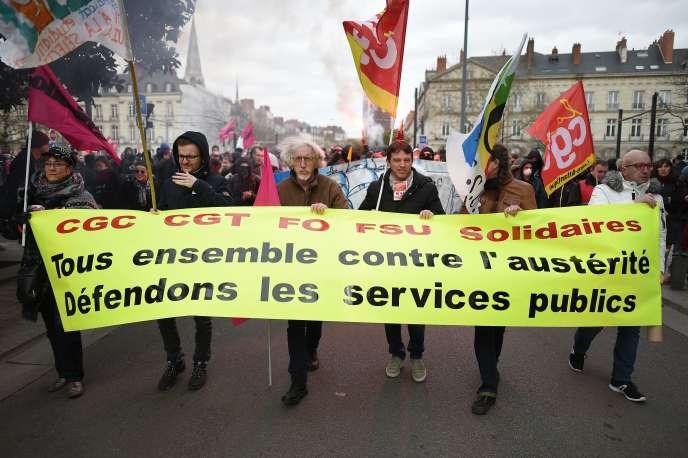 Durant la manifestation de la fonction publique et des cheminots, jeudi 22 mars, à Montpellier.