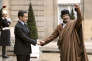(FILES) In this file photo taken on December 10, 2007 Libyan leader Moamer Kadhafi arrives 10 December 2007 at the French Elysee Palace in Paris for a meeting with French president Nicolas Sarkozy. Former French president Nicolas Sarkozy has been called in for questioning by investigators looking into suspected Libyan financing of his 2007 election campaign, a source close to the inquiry told AFP on March 20, 2018. / AFP / Eric Feferberg