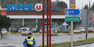 A French gendarme secures the access to a supermarket after a hostage situation in Trebes, France, March 24, 2018. REUTERS/Jean-Paul Pelissier