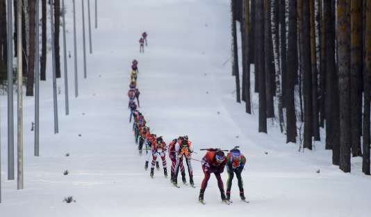 Skiers compete during the Biathlon men's World Cup 15km mass start event, in Tyumen, Russia, Sunday, March 25, 2018. (AP Photo/Sergei Grits)