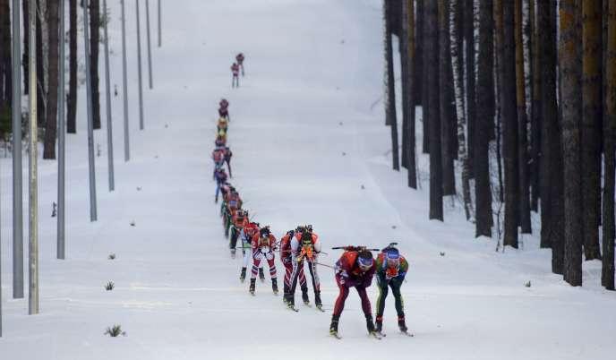 Skiers compete during the Biathlon men's World Cup 15km mass start event, in Tyumen, Russia, Sunday, March 25, 2018. (AP Photo/Sergei Grits)
