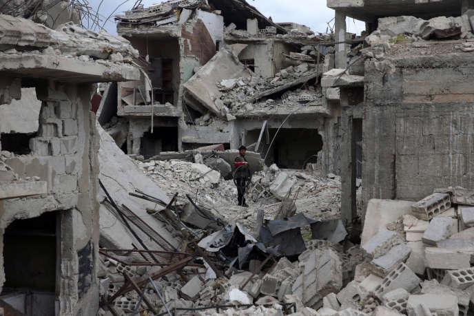 Maisons en ruines dans la Ghouta orientale, près de Damas, le 30 mars.
