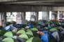 Campement de migrants sur le canal de l'Ourq, à proximité du centre commercial Le Millénaire, à Aubervilliers.