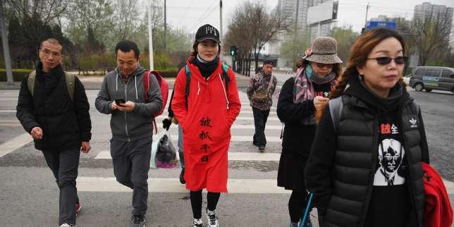 Chine li wenzu femme d un avocat disparu marche pour attirer l attention sur le sort de son mari - Femme morte sous les coups de son mari ...