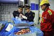 Inspection d'importation de viande par les douanes à Qingdao, dans la province du Shandong (Chine), le 23 mars.