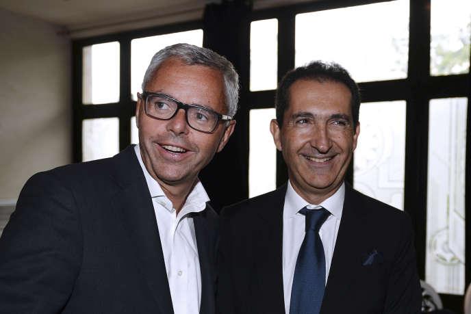 Michel Combes avec Patrick Drahi, fondateur et président du groupe Altice, à Paris, en septembre 2016.