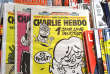 The last issues of the German version of French satirical weekly Charlie Hebdo are for sale at a newsstand in Berlin on November 30, 2017. A year after its launch, the German version of Charlie Hebdo will stop appearing for lack of readers, announces the newspaper in its latest edition. / AFP PHOTO / John MACDOUGALL