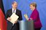 La chancelière allemande Angela Merkel et le ministre des finances et vice-chancelier Olaf Scholz lors de la conférence de presse du 11 avril, à Meseberg, au nord-est de l'Allemagne.