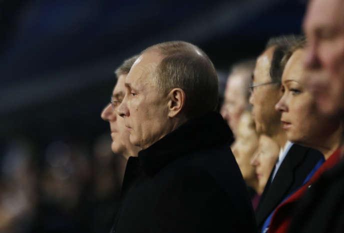 Le président Vladimir Poutine (à droite), au côté du président du CIO, Thomas Bach, à Sotchi, en février 2014.
