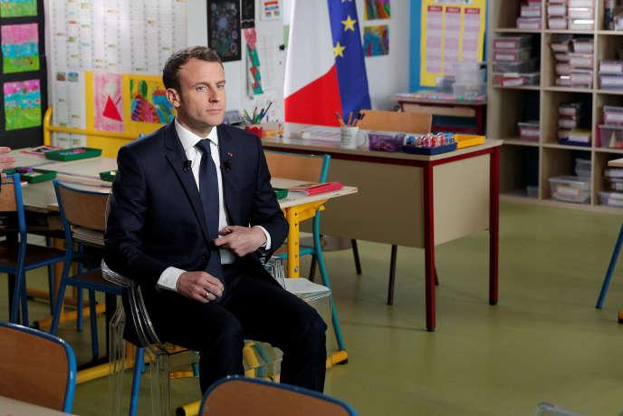 Emmanuel Macron, au début de l'interview au journal télévisé de 13 heures de TF1, le 12 avril.